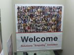 A Welcome poster showing many faces