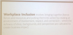 projected slide defining workplace inclusion