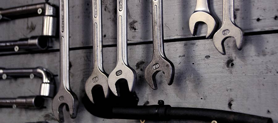 Hand tools hanging on a wall.